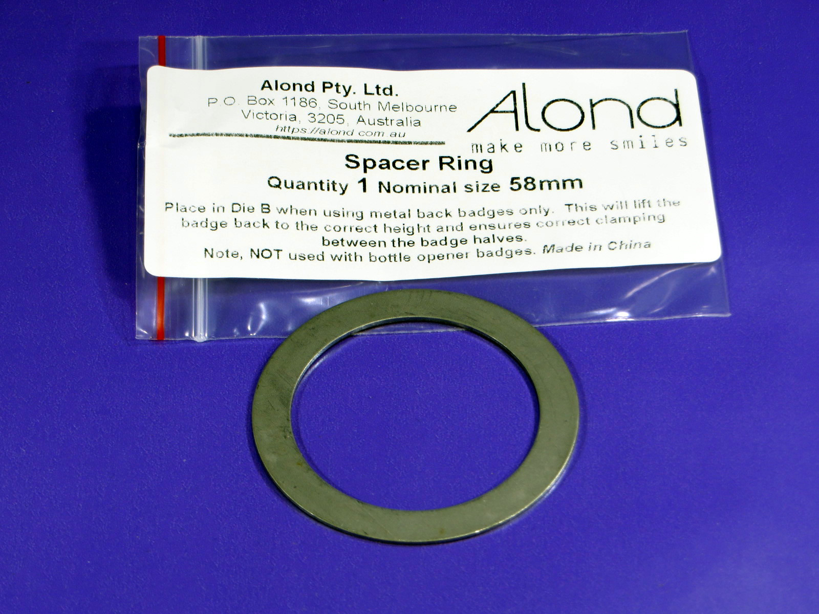 Specer ring to allow the use of metal back badges in badge-makers