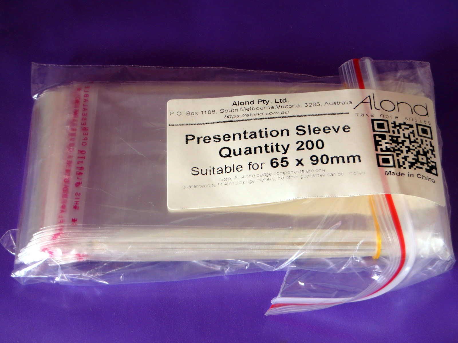 Alond badge presentation sleeve shown within outer package