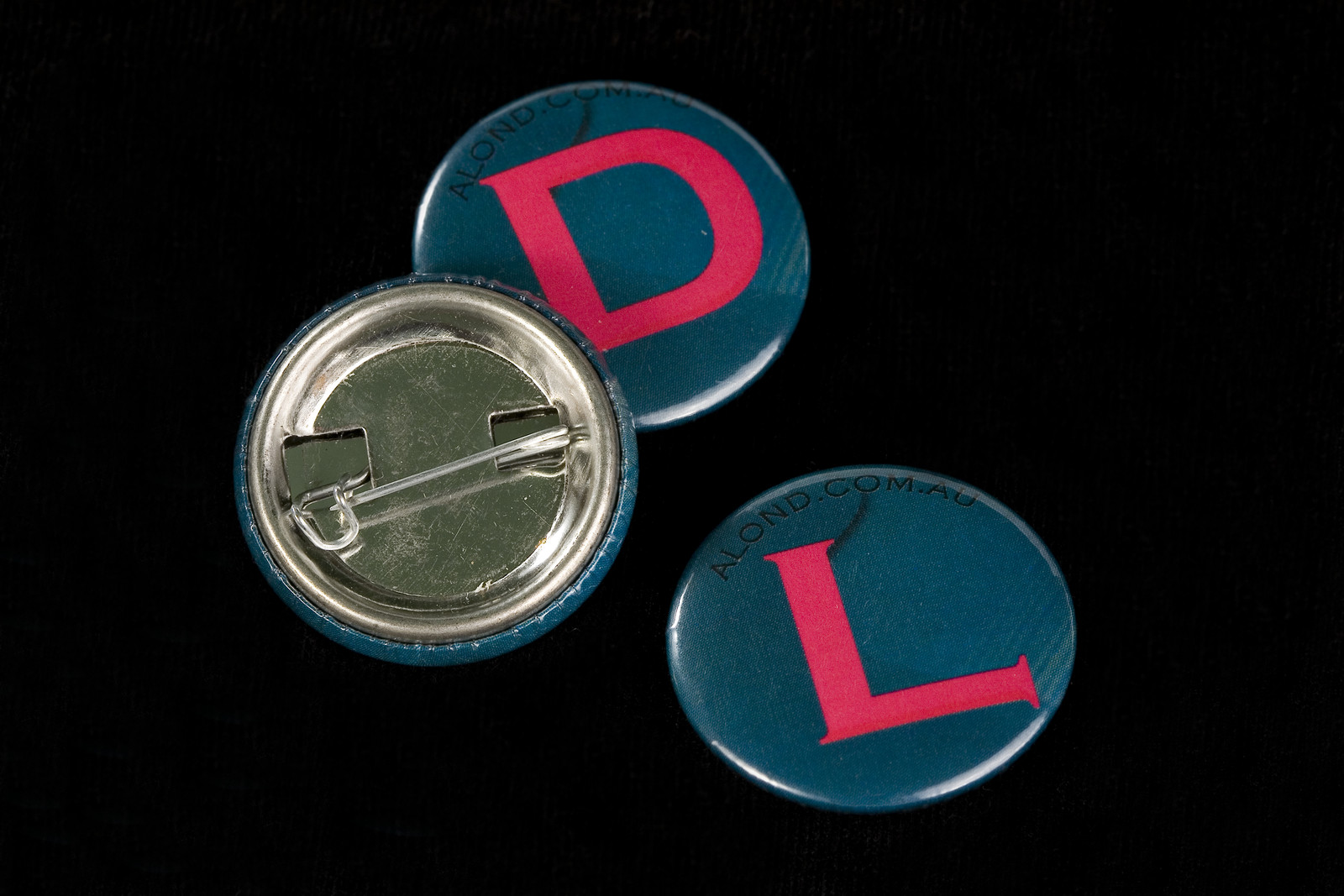 one inch metal badge with pin