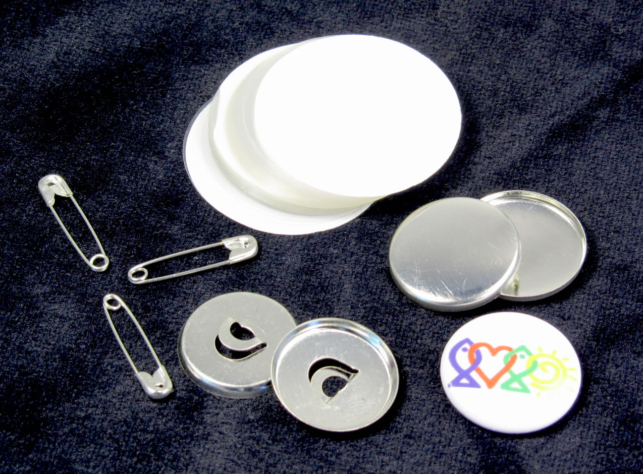 showing components for a 20mm safety-pin badge