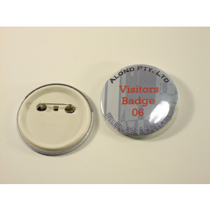 Image of 75 mm plastic back badge, showing front and back of the badge