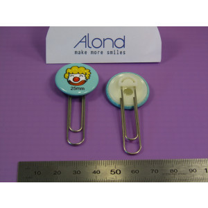A very creative 25 mm badge with an attached paperclip