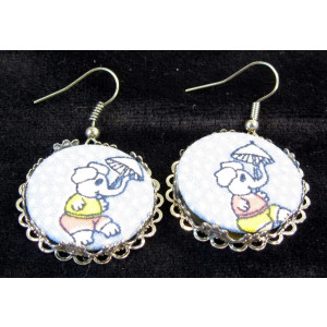 Earrings showing fabric inserts made on the Alond badge maker